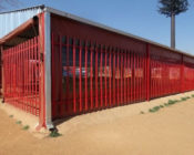 Red fence with silver roof